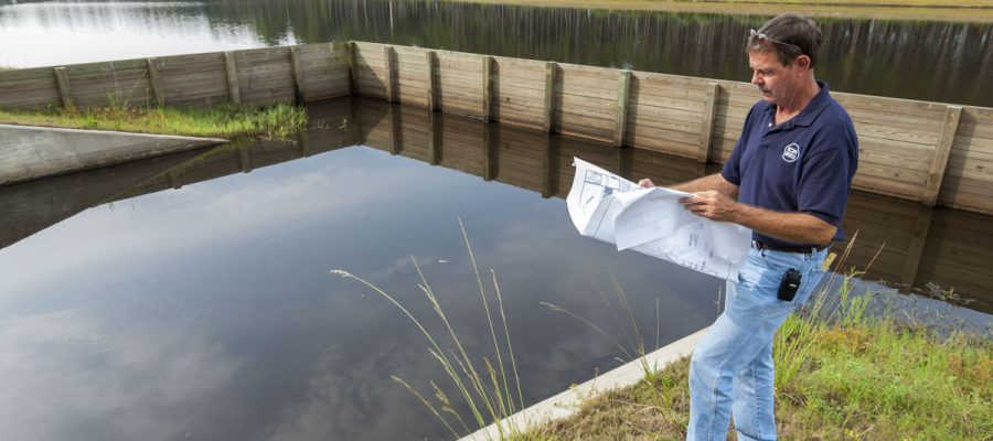 Vern Wickline inspecting stormwater system at Nocatee community in St. Johns County