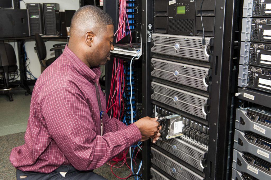 District staff working on network storage equipment