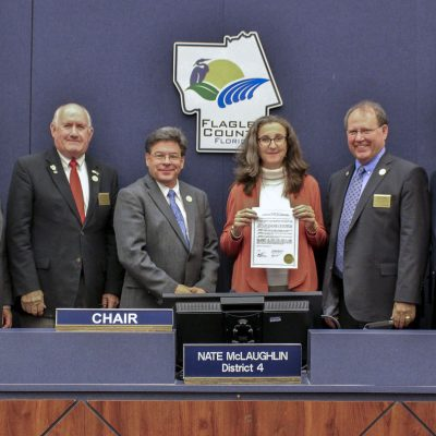 Deirdre Irwin with Water Conservation Month proclamation at a local government meeting
