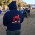 Person standing with Wildland Fire Management hoodie