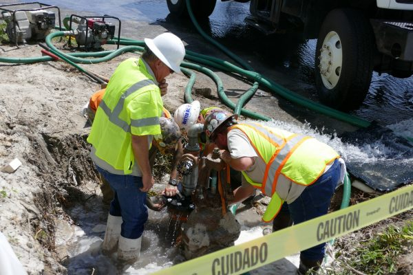 District staff on site of a well plugging operation