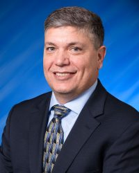 Governing Board chairman John A. Miklos