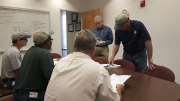 Staff meeting about Hurricane Matthew