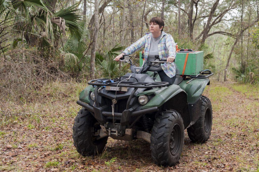 District staff riding an ATV