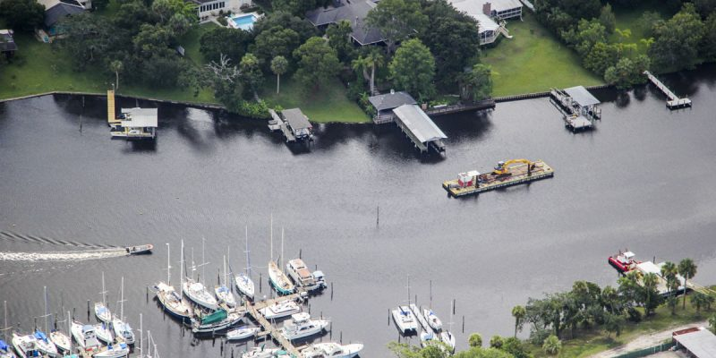 The St. Johns River Water Management District is leading a project to remove more than 600,000 cubic yards of organic muck from the Eau Gallie River in Melbourne.