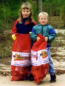 Kids with bags of trash during the St. Johns River Celebration