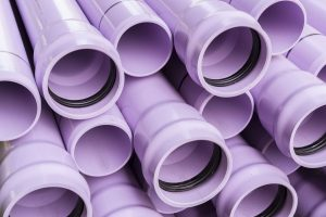 Stack of purple pipes used for reclaimed water lines