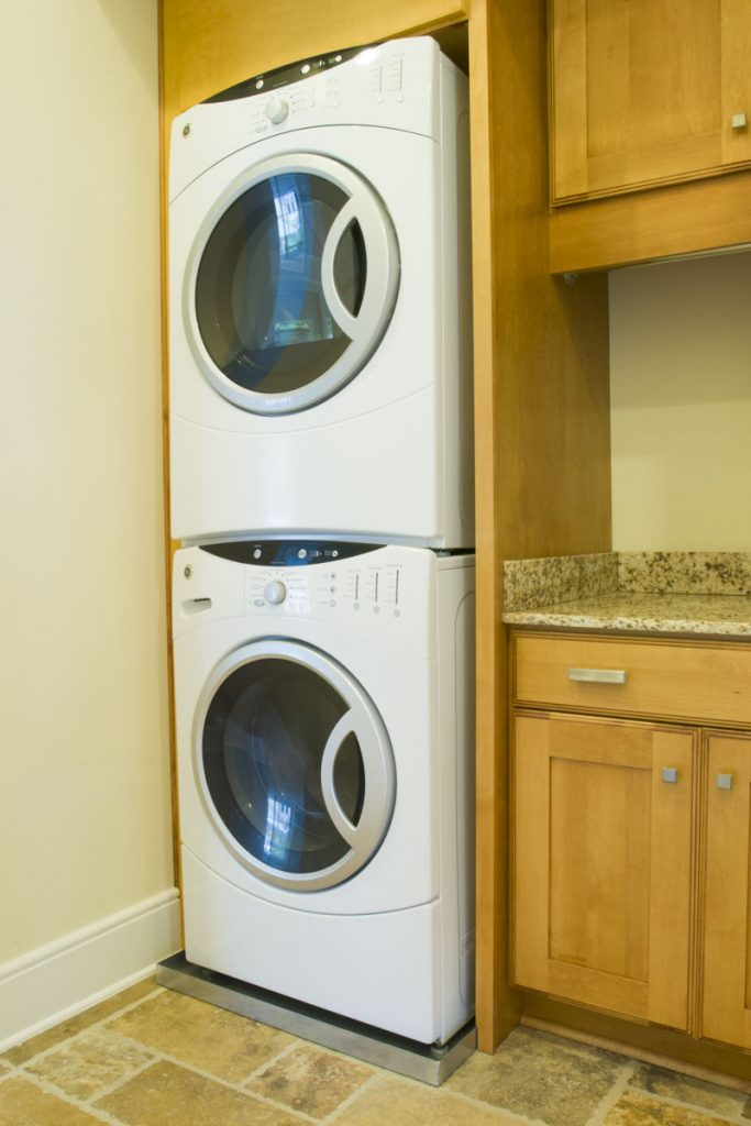 Stacked front loading washer and dryer