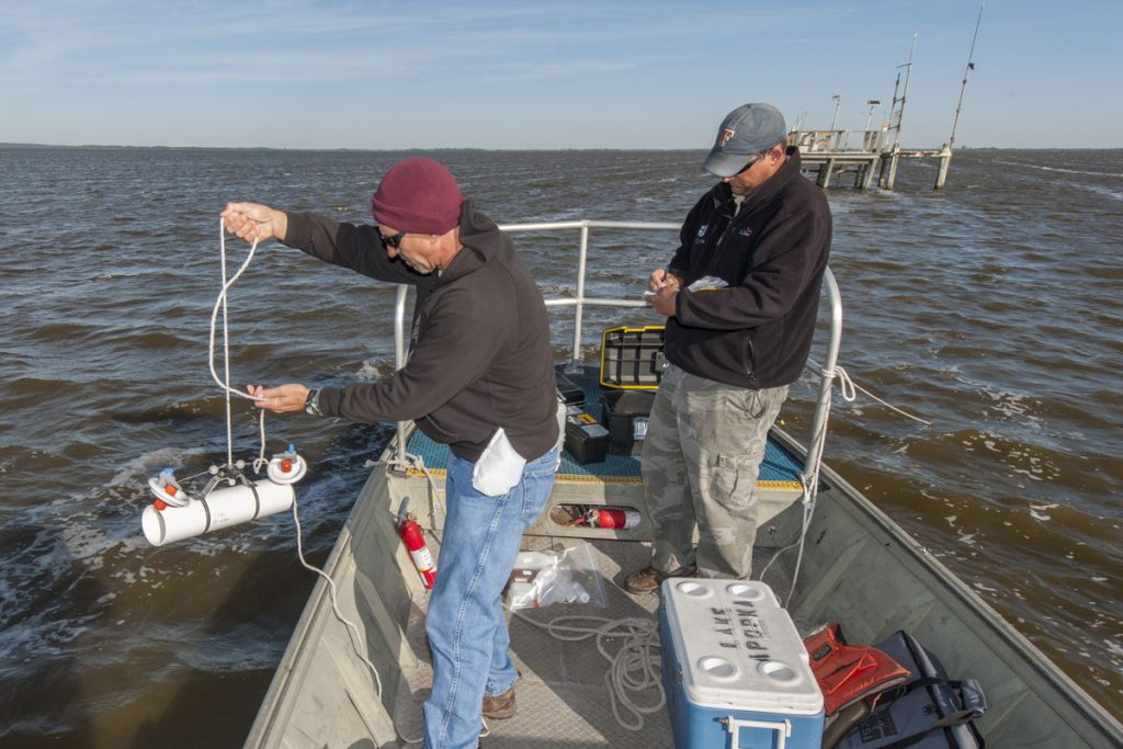 Paul Ek and Charles Smith collecting water samples on Lake Apopka