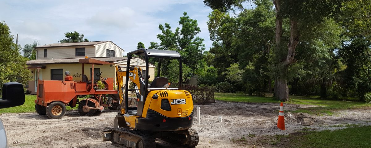 Construction equipment sitting outside of a house