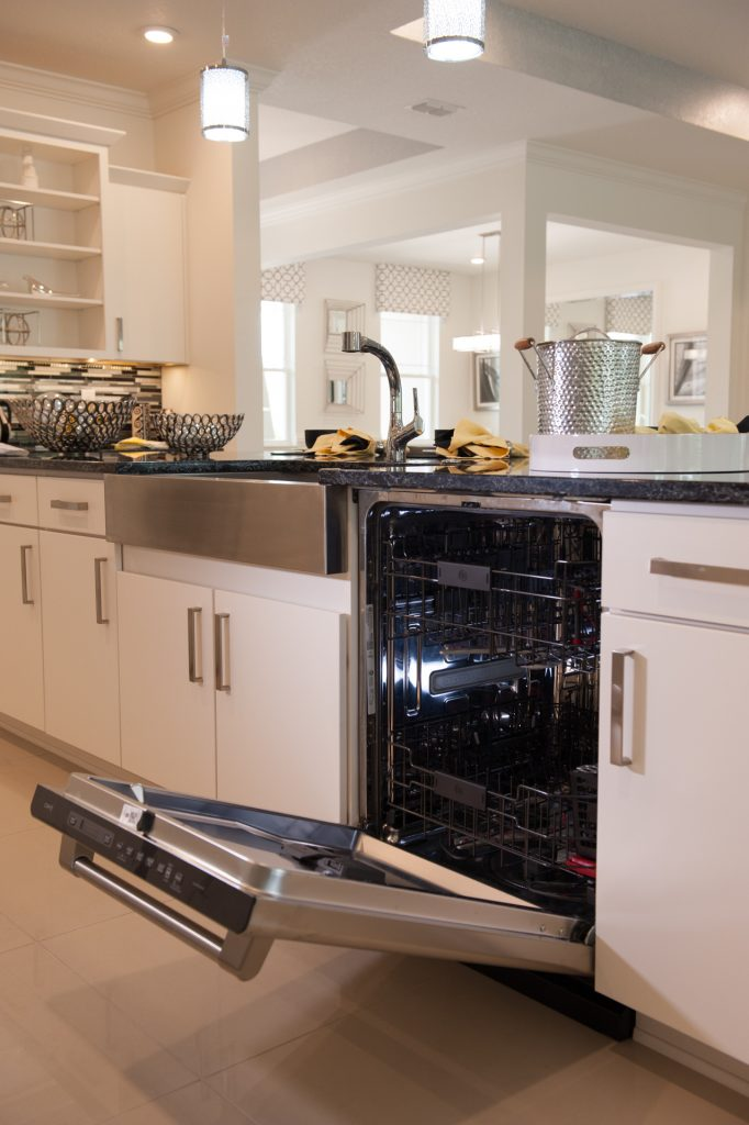 Kitchen with an opened dishwasher