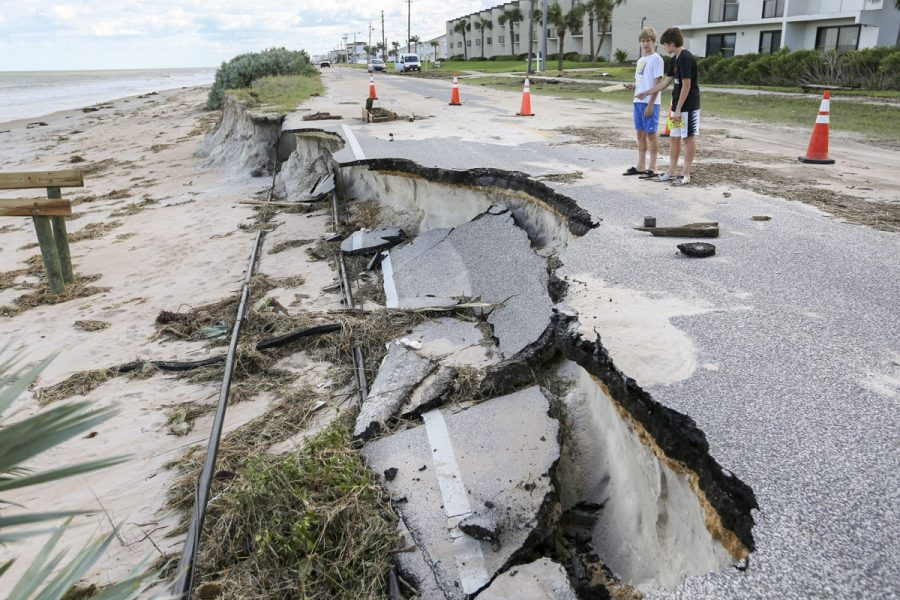 Road next to the ocean that is partially washed away