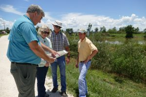 Dr. Erich Marzolf touring the Lake Apopka Marsh Flow-way with Dr. Ann Shortelle, Karl Hankin and Bob Nalway