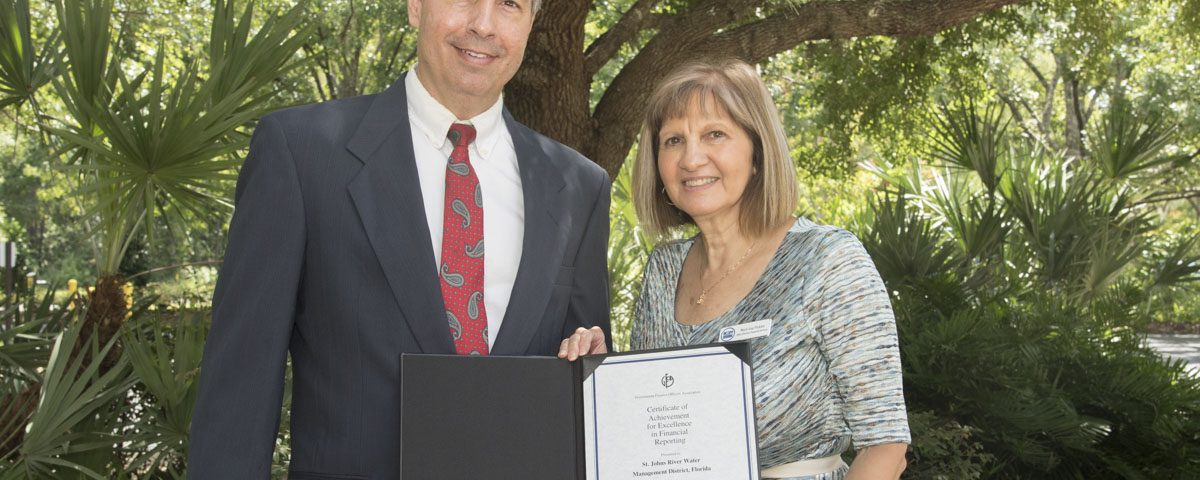 Mary-Lou Pickles and Greg Rockwell with a finance award