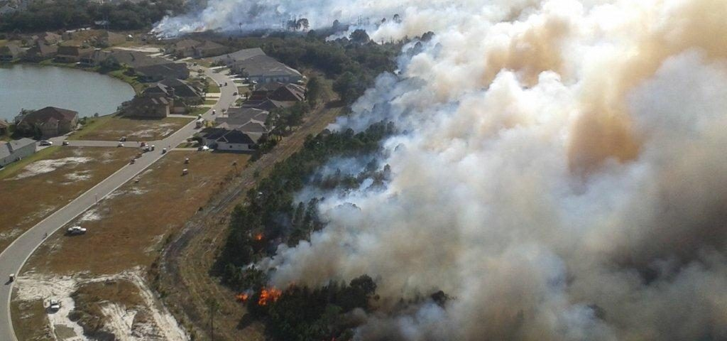 Aerial of a prescribed fire burning next to a neighborhood