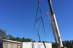 Crane lifting a large generator during installation at Palatka wastewater treatment plant