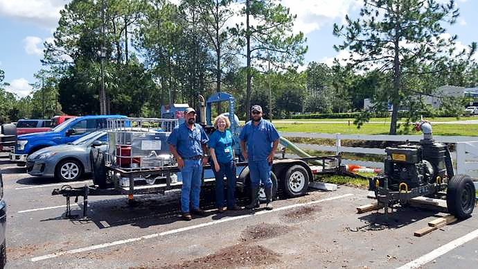 Dr. Ann Shortelle visiting staff that are pumping floodwater in Palatka