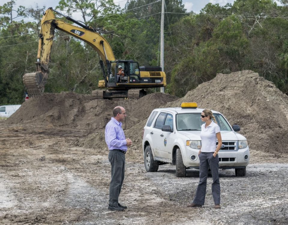 Melisa Diolosa meeting with the City of Fellsmere's community development director at a stormwater project