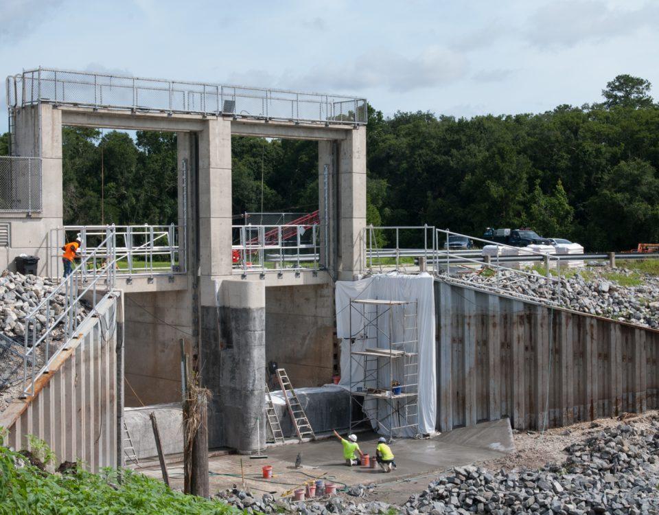 The Moss Bluff flood gate being resurfaced