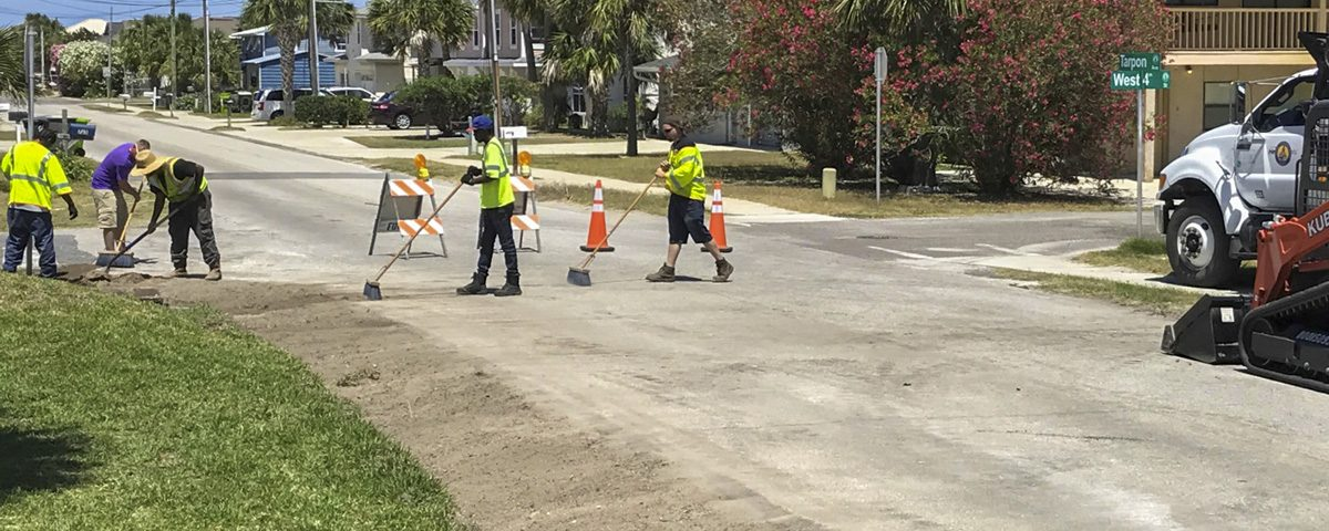 Crews working on Tarpon Avenue swales.