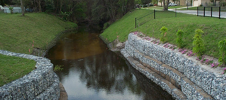 Gabions (cage filled with rocks) on the banks of a creek