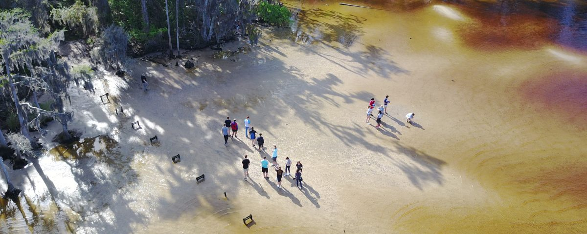 Aerial of students on the shore of the St. Johns River near Jacksonville