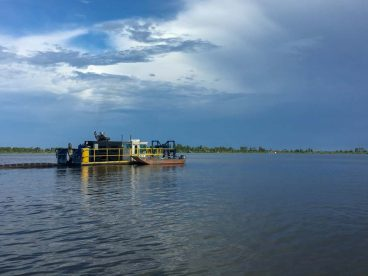 A photo of a sum pump barge in operation on Lake Apopka