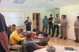 "District staff prepare for today's prescribed fire at Lochloosa Wildlife Conservation with a burn briefing led by Land Resources Bureau Chief Steven R. ""Torch"" Miller."