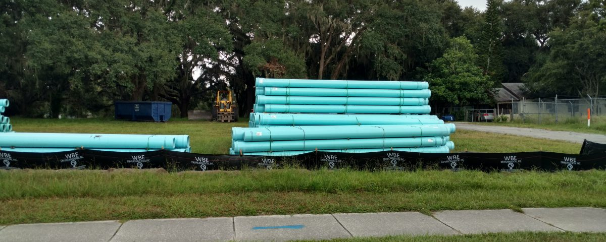 Stacks of large water pipes in a field