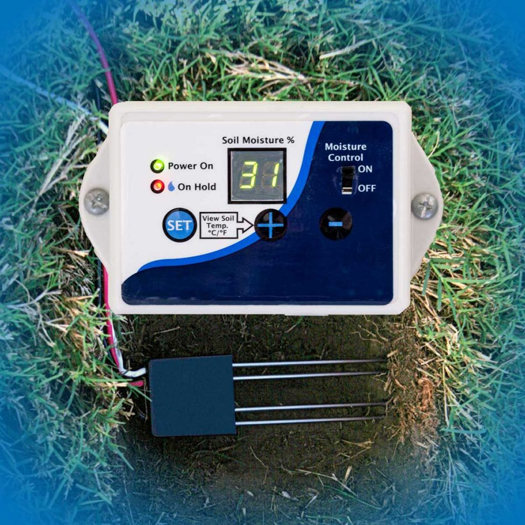 Soil moisture sensor sitting on grass