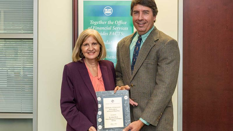 Mary-Lou Pickles, director of the Office of Financial Services, and Greg Rockwell, accounting director.