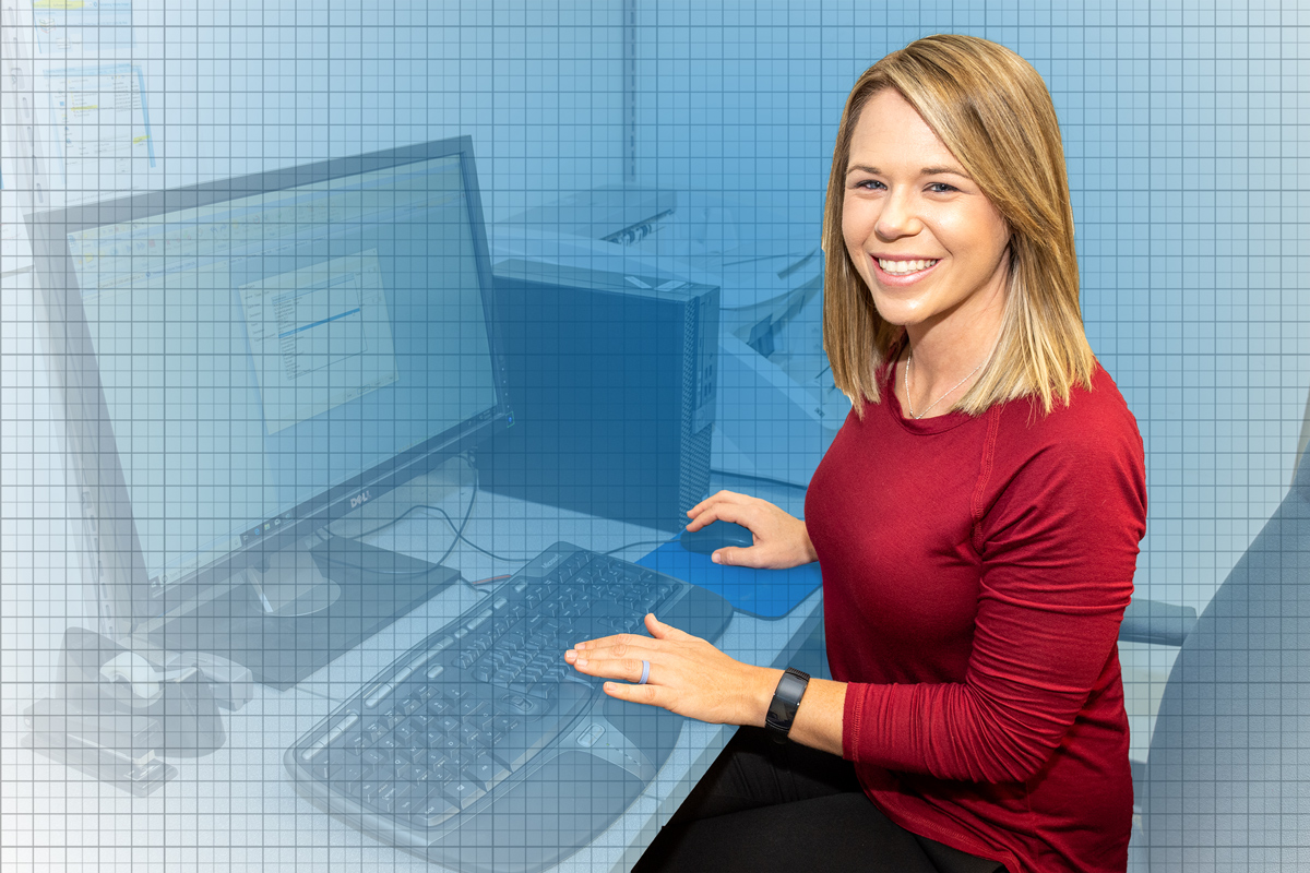 Portrait of Sara-Driggers working at a computer