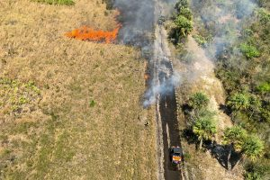 Aerial image of a prescribed fire burning in an open field