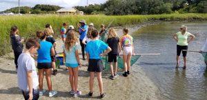 Kids stnasing on a shore