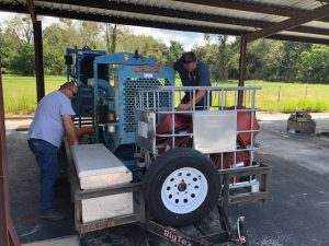 District staff working on pumping equipment