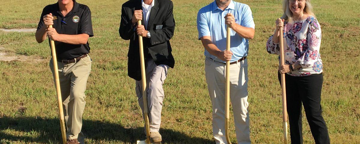State representatives holding golden shovels
