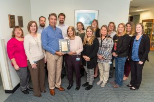 Office of Financial Services staff receiving an award