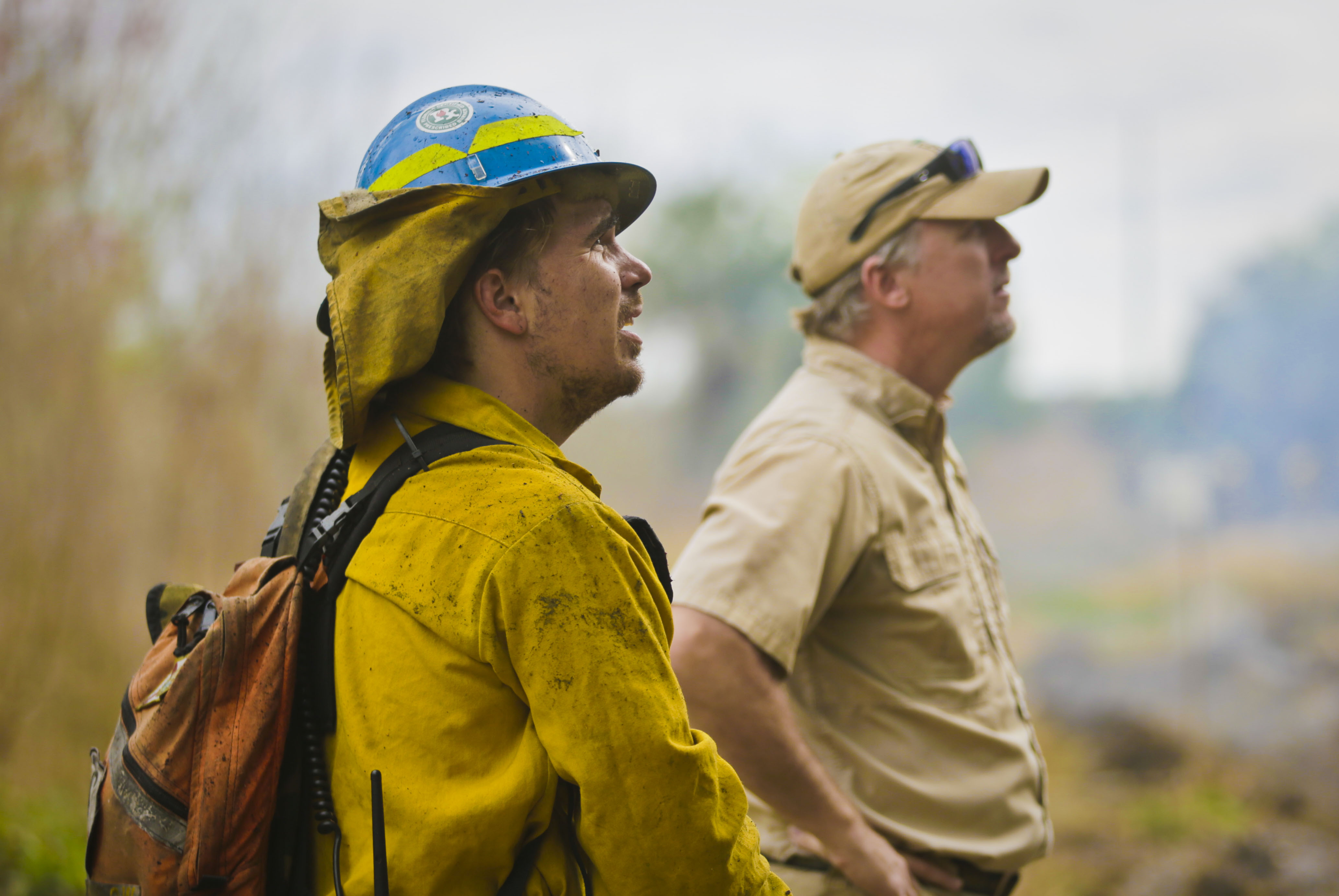 Land Manager Chris Kinslow (left) monitors conditions of a prescribed fire