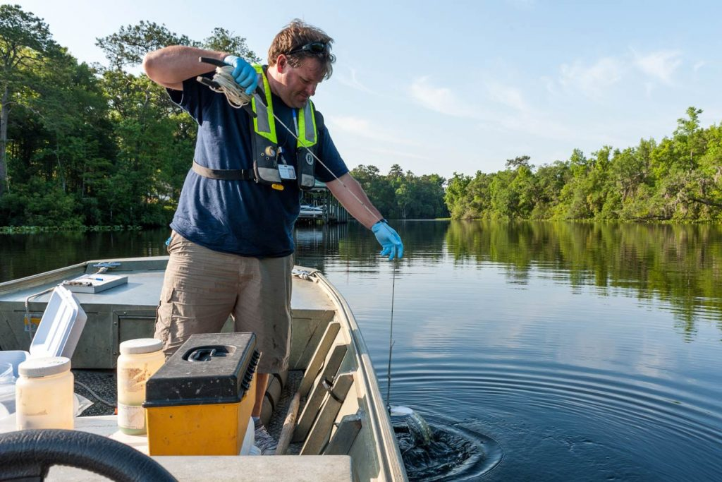 A District scientist uses a Secchi disk to determine water quality