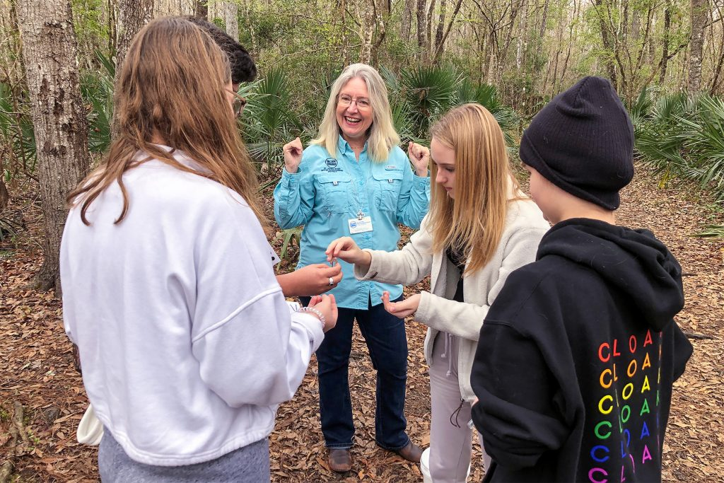 Dr. Ann Shortelle with students in the woods
