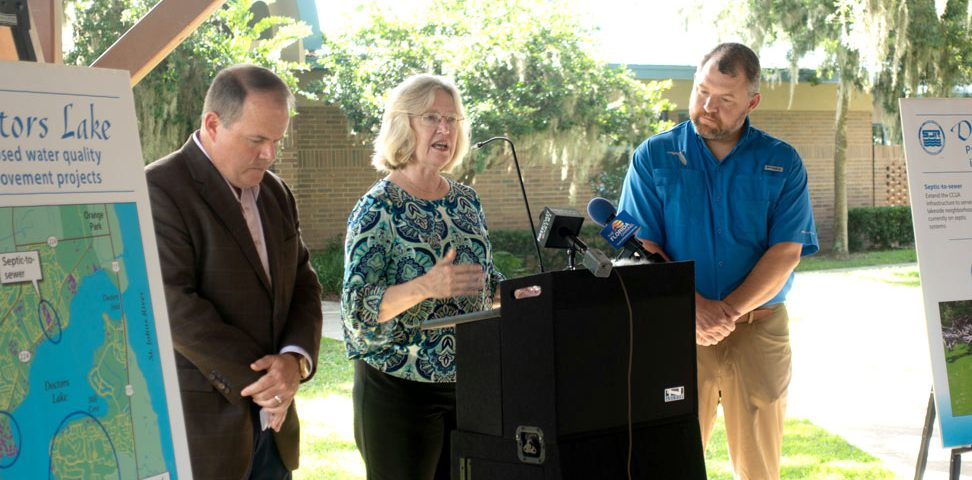 Pictured: Rep. Travis Cummings, District Executive Director Dr. Ann Shortelle and Sen. Rob Bradley at the August 2018 legislative funding announcement event.