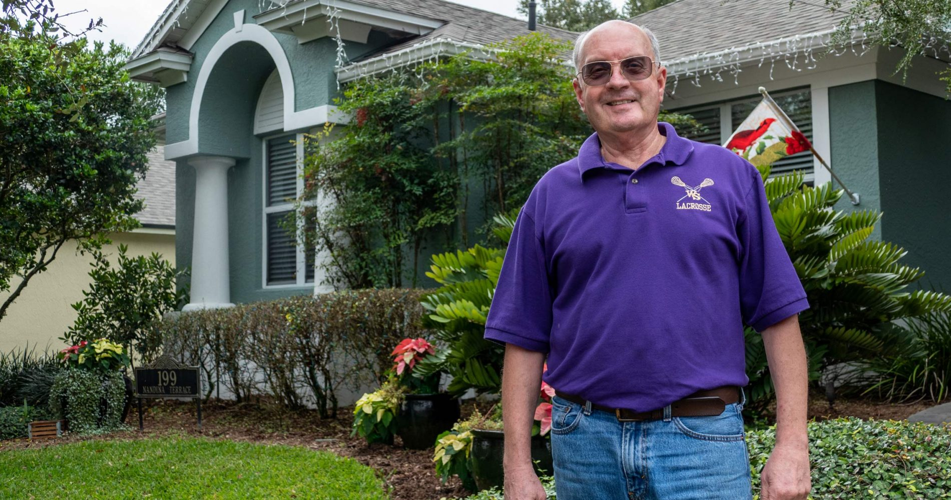 Art Gallo standing by his home