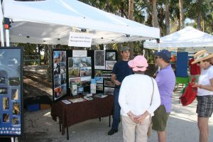 Amy Copeland talks with members of the public at an outdoors event