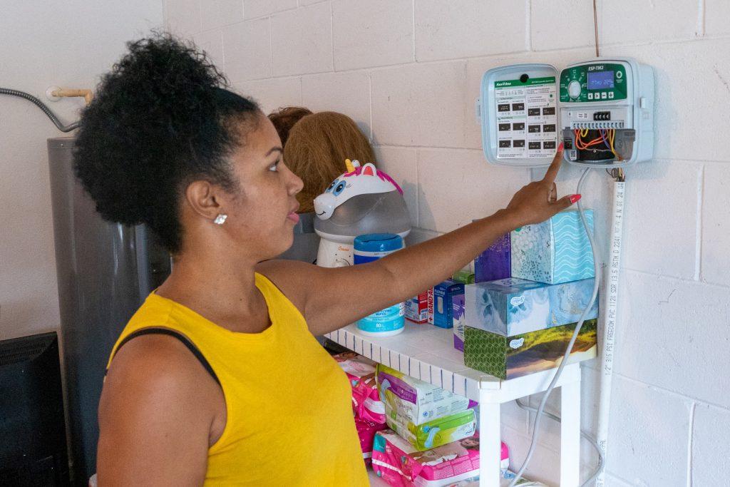Miky Ynirio using her sprinkler system