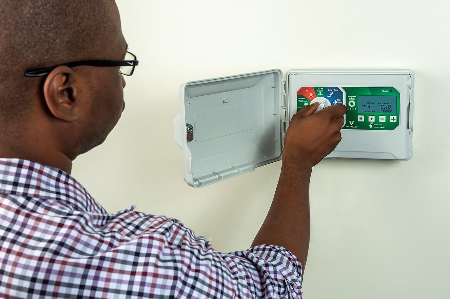 District employee setting sprinkler system