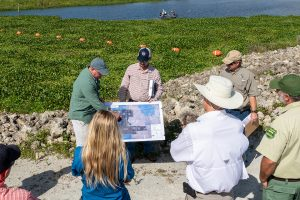 Members of the Land Management Review Team studying maps