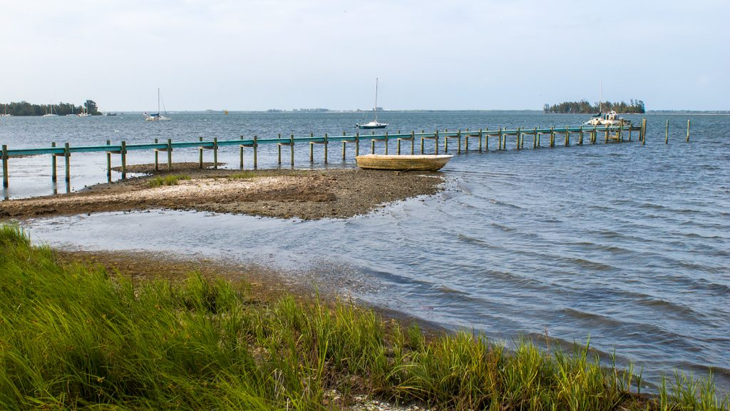 A pier extending out in to the Indian River Lagoon