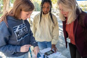 Dr. Ann Shortelle showing students water-quality technology
