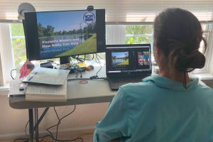 The district's Dr. Jennifer Mitchell leads a virtual training for community association managers
