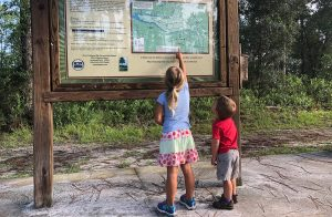 Boy and girl looking at a trail map